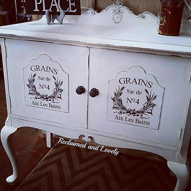 Reclaimed and Lovely shared this beautiful painted buffet on Instagram.  She used Artisan Enhancements Transfer Gel to apply the French graphics to the doors!