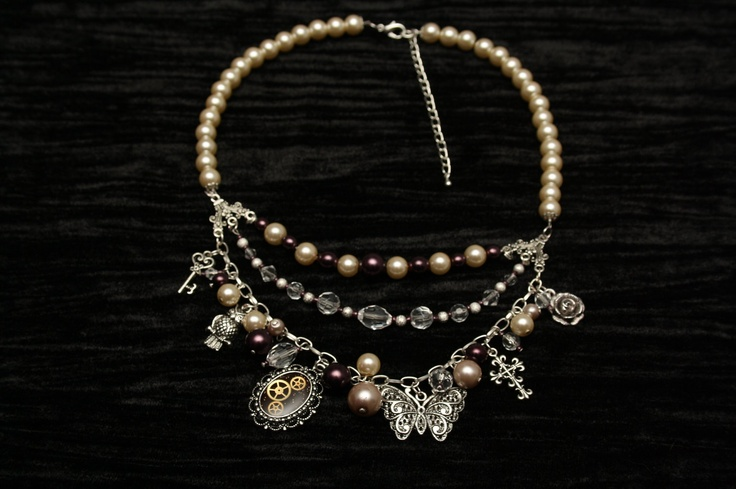 Triple Strand Necklace with Burgundy Pearls and Silver Charms. $40.00, via Etsy.