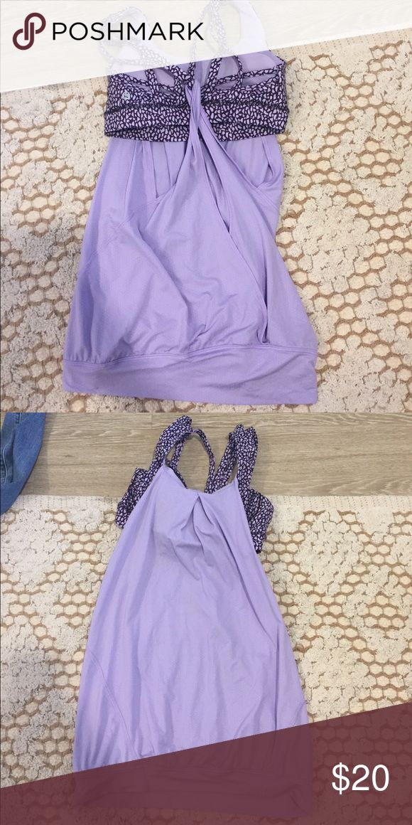 Lululemon lavender tank top with built in bra Strappy built in bra is an animal print type with the same lavender color and a darker purple. The rest of the tank top is flowy and airy. Great for hot yoga classes. Size 4 from lululemon. Worn a few times. lululemon athletica Tops Tank Tops