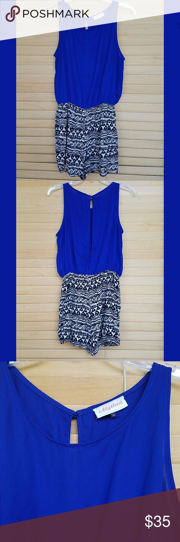 Alythea Sleeveless Romper Unique and trendy romper from Alythea - purchased at a small boutique in Coconut Grove (Miami, FL).  Polyester and Rayon, sheer top with open back and button closure at the top.  The top and bottom are connected by an elastic waistband.  The bottom are flowy shorts with a cool tribal-ish pattern.  It's been worn twice and is in great condition. Alythea Pants Jumpsuits & Rompers