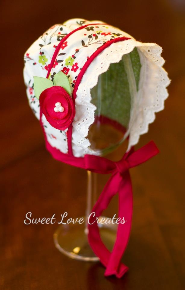 What a sweet baby bonnet!  Gonna have to start trying some of these with my crochet hooks....