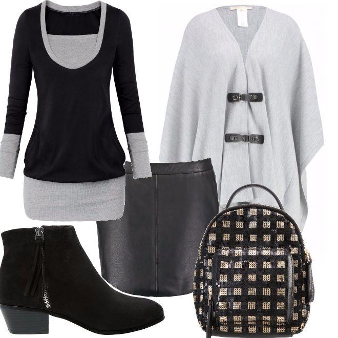 Una mantella in lana grigia, con due ganci, è il punto forte di questo abbigliamento casual, adatto per tutti i giorni. Ho aggiunto una maglia nera con profili grigi, una minigonna di pelle, dei tronchetti bassi e uno zaino di Pinko bicolore e allegro.