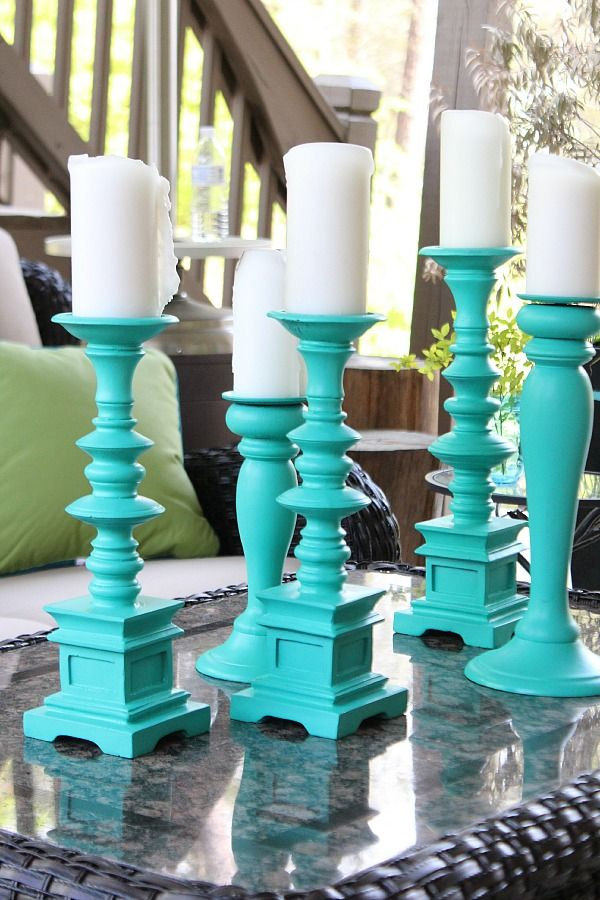 Thrift store makeover:: Spray paint mis matched candle holders for a beautiful aqua statement