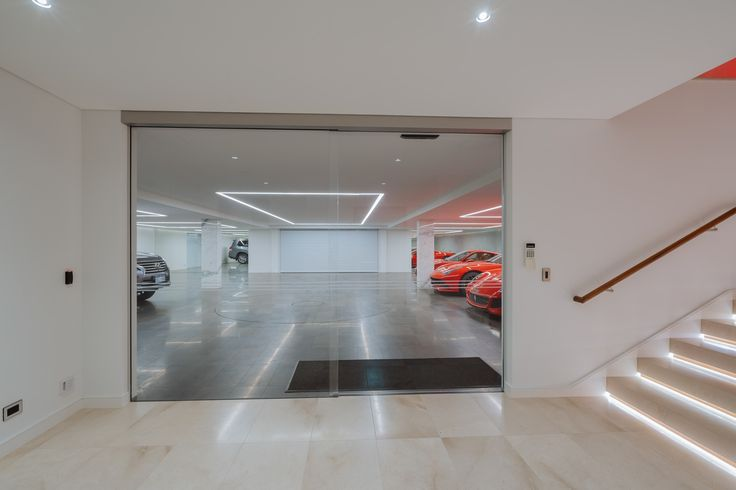 Re-defining Undercroft Garage With Marble Pillars, Mirrors