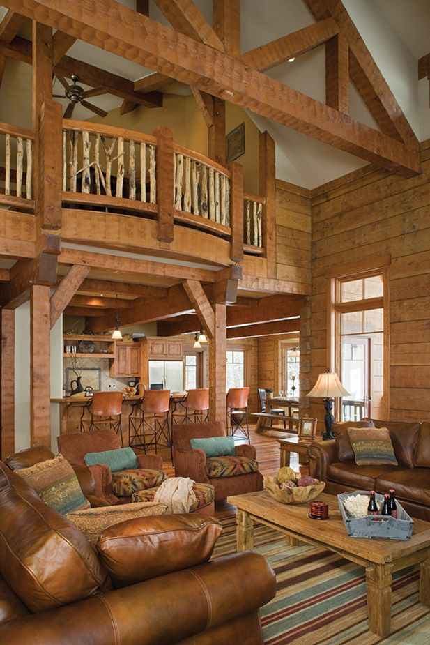 Log Home Great Room: Featuring Handcrafted Timbers and Square, Milled Log Walls      Recognized for its focus on mountain style architecture, the award winning team at PrecisionCraft Log Homes & Timber Frame and Mountain Architects has custom designed thousands of log homes and cabins worldwide bringing them to life using the industry's only Design Build Best Cost program.