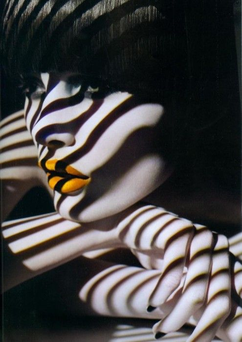The shadows on her face and is the colour on her lips yellow or orange?  Intriguing!