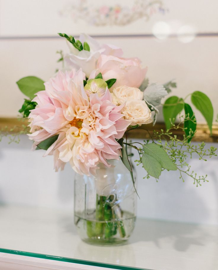 lovely petite posie for the mother of the bride of cafe au lait dahlia, white freesia, juliette garden rose, white stock, dusty miller and seeded eucalyptus.