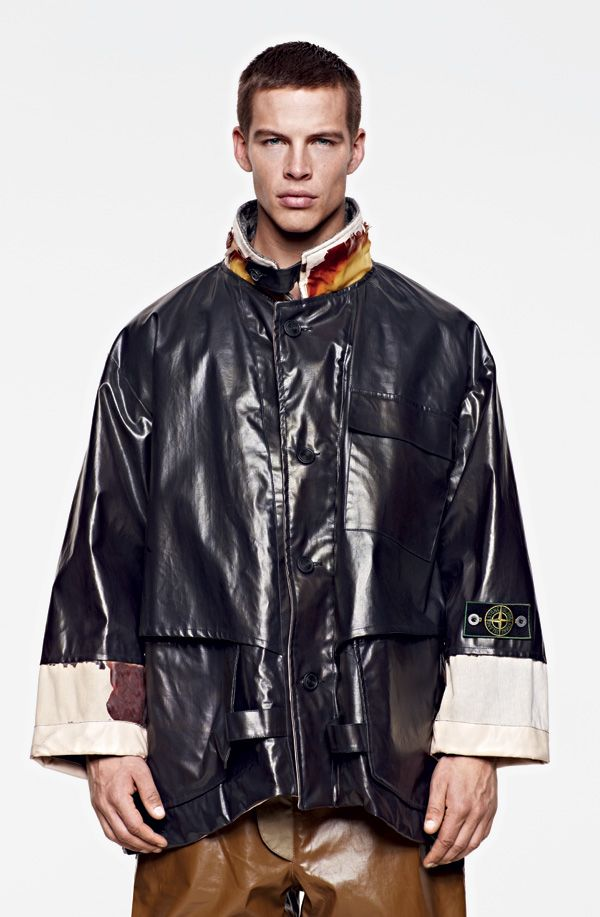 Stone Island 1983 cotton canvas with a thick matte PVC coating and latex detailing.