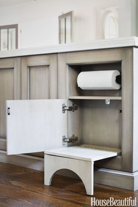 A niche in the kitchen island keeps paper towels close at hand. Also built in: a collapsible step stool to help kids reach the countertop.