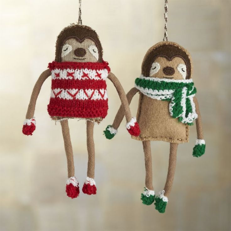 Thse winterized sloths drape long, lanky limbs, cozied up in a hand-knit sweater and matching mittens.  Nothing says the holiday like a sloth in a sweater! Defining her style as folk pop, Canadian designer Sabina Gibson is a master of soft sculpture.  Her charming plush ornaments are stitched by hand into colorful and delightful characters inspired by holiday folktales and long Montreal winters. Wool, cotton, polyesterMade in India.