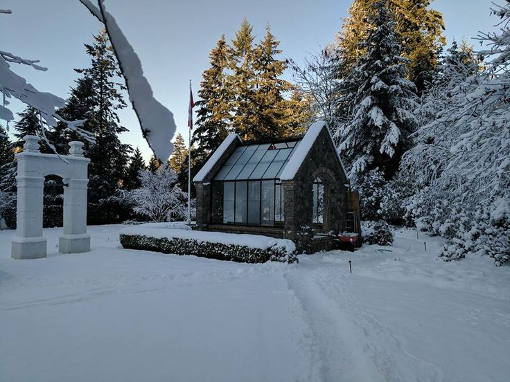 Custom greenhouse with stone gable ends by BC Greenhouse Builders