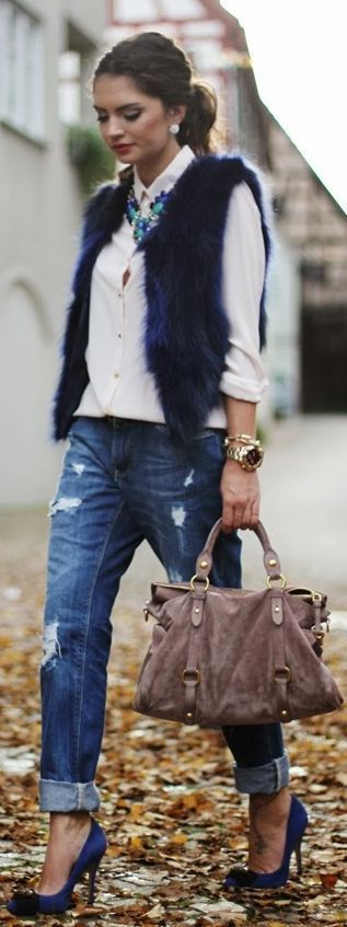 Dressy casual: Boyfriend jeans, white blouse, blue accented necklace, blue tinged fur vest, cobalt blue heels: