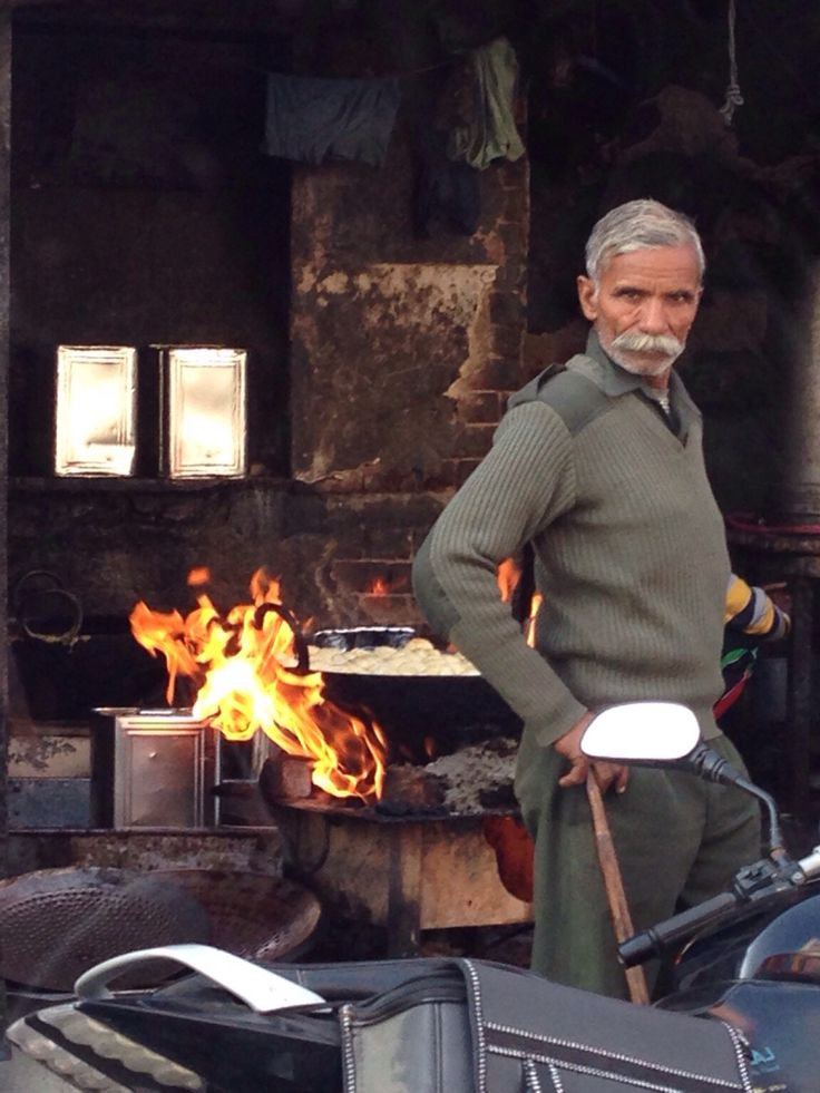 Strike a pose. An old man standing in front of a food stall in a market in Agra-India. Copryrights Vivi Kembang Tanjoeng