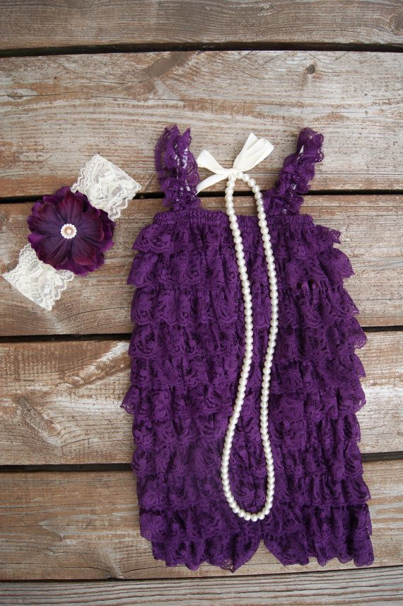 This romper is made of a deep purple soft lace. We are pairing it with an ivory lace headband with a perfect matching flower. Embellished with