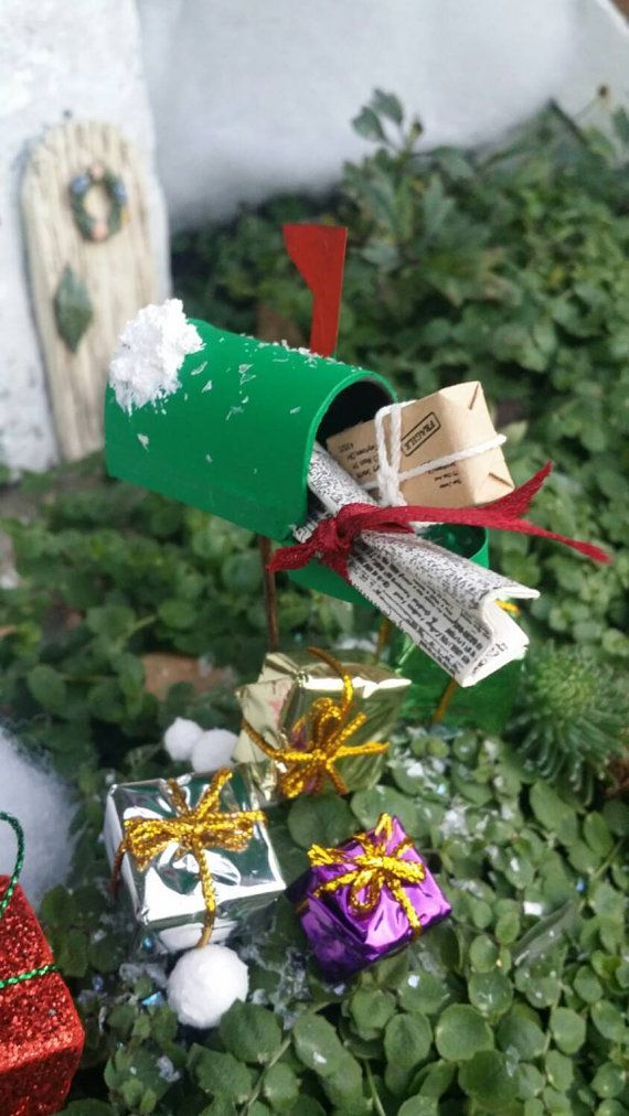 Looks like theres a Special Delivery for the fairies!! Wrapped packages and a newspaper from the Miniature times!! The mailbox is green, with the red flag and theres been some new fallen snow on the mailbox too! Doesnt get much more festive than this mailbox! Measures: 1 W x 1.5 Deep x 1 H / Pick 4 H