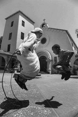 Mother Teresa jumping rope with an orphan