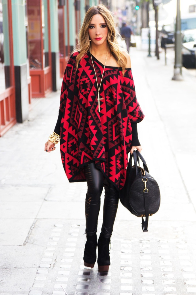 oversized tribal print sweater over faux leather leggings.