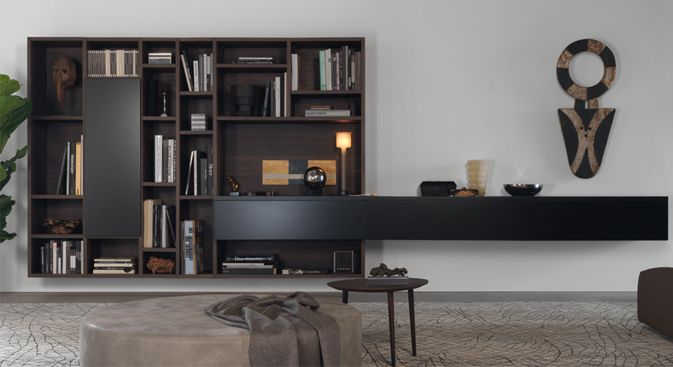 Open 21 wall unit consists of open displayshelves, a vertical cabinet andalong horizontal wall mounted shelf for media andstorage. The Open 21 comes with the option of a cable duct at the back to concealcables and wires.