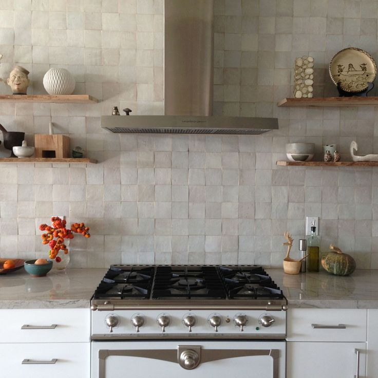White moroccan zellig tile, La Cornu range, contemporary stainless steel range hood, natural quartzite countertops