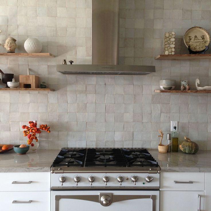 White moroccan zellig tile, La Cornu range, contemporary stainless steel range hood, natural quartzite countertops