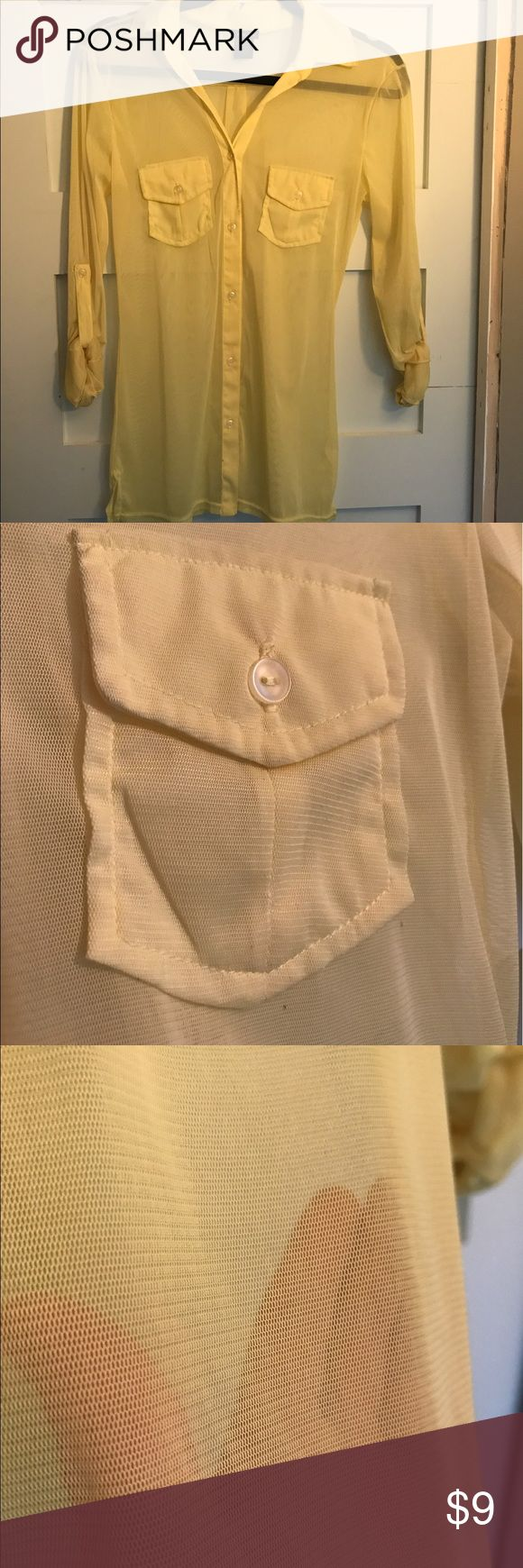 Rue 21 Yellow See Through Blouse Unique light yellow mesh button down blouse. Roll up button sleeves and two pockets across the chest. Has extra replacement button on back of tag. Has makeup spec below last button. (Might come out). From a smoke free home! 100% polyester. Rue 21 Tops Blouses