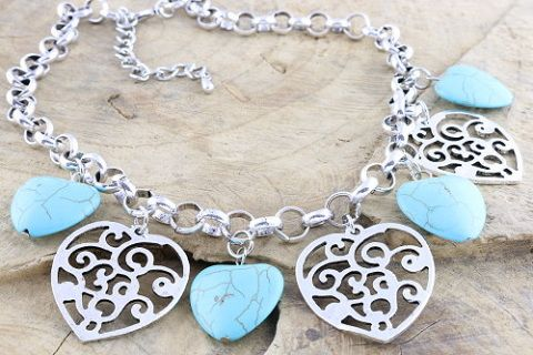 A Pretty Simulated turquoise and metal heart charm necklace on a belcher chain.    Necklace length 45cm + 7cm extension chain.