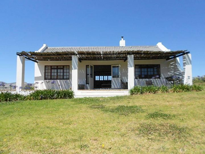 Babylon's Tower Cottage accommodation near Hermanus, Western Cape. With a long voorstoep spilling gentle Hemel en Aarde vistas, and an elegant understated interior of muted tones, exposed beams and screed floors, this one will have you in it's grip in no time.