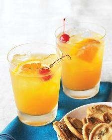 Whiskey Sours (or Bourbon Sours) - orange juice, lemon juice, tripe sec, whiskey or bourbon, orange slices, maraschino cherry