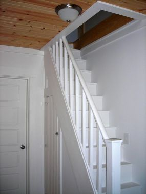 """finehomebuilding.com Having a wide hall (and a predilection for stairs), a tiny staircase leading to the attic with a built-in closet underneath seemed a perfect fit - especially for an """"old"""" New England farmhouse."""