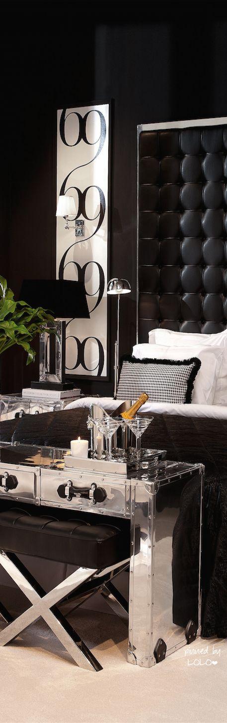 Headboard & side art combine as one in contemporary bedroom.