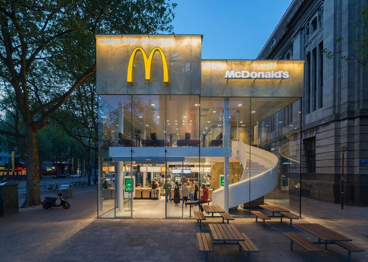 "This McDonald's with a perforated golden facade and a spiral staircase was designed by Mei Architects to replace ""the ugliest building in Rotterdam"""