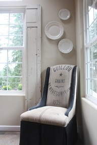 An old door cut in half to make faux shutters (from My Sweet Savannah)like the chair and window