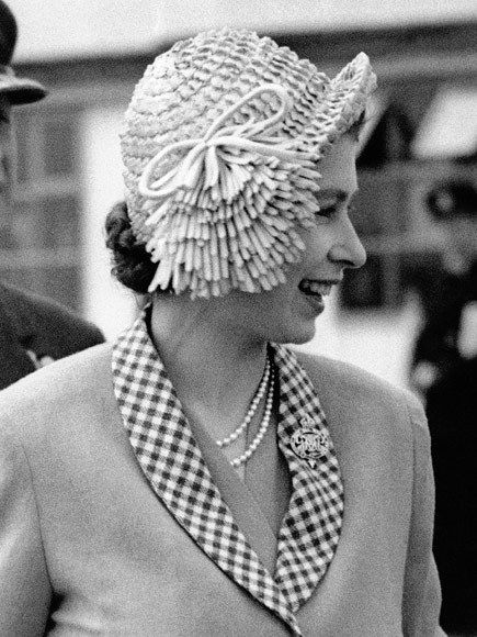 STRAW LADY Of course, the Queen's hat game has always been strong, even before she became Queen. Back in 1949, the monarch-to-be wore a distinctive straw hat in London.