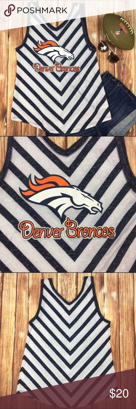 """Denver Broncos Juniors Chevron Print Tank Size: Juniors XL 15/17 Brand: NFL Teen Apparel  Condition: Excellent, pre-owned  White & navy blue chevron print tank top. Large bronco head & team name printed on front. No cracking of print.   Juniors size XL (15/17), could also fit women's small. Check measurements for sure fit.   Fabric: 88% Polyester, 12% Cotton Measurements:  17"""" bust from underarm to underarm 27"""" length from shoulder to hem 2"""" strap width NFL Apparel Tops Tank Tops"""