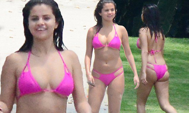 Selena Gomez flaunts her slender curves in a skimpy pink bikini
