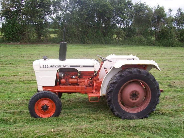 My daddy had a little David Brown 885 Tractor like this. He always looked so cute zipping around on it. It is now parked in the field, long past use from the wear and tear of farming, but it brings back a lot of memories.