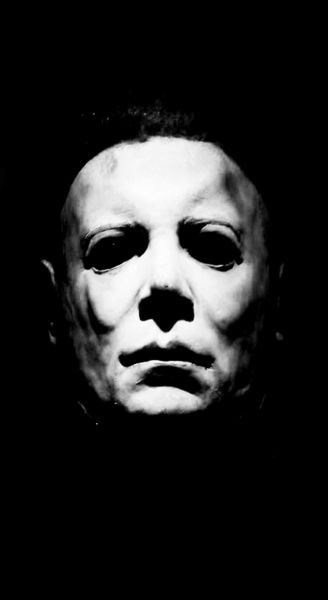 Michael Myers, a fictional character from the Halloween series of slasher films.  Creepy!