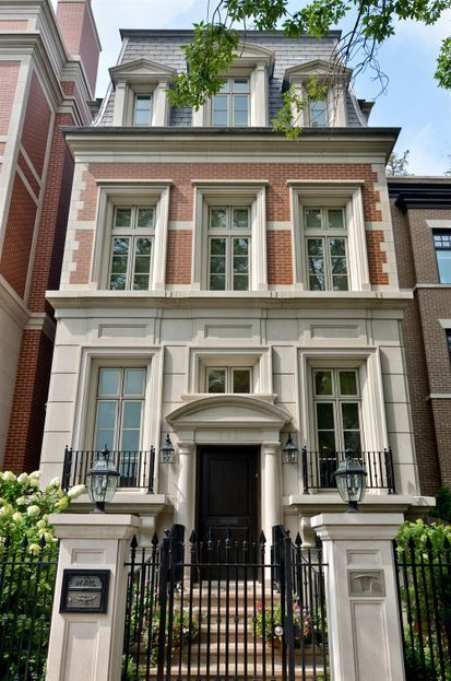 This brick and limestone new-build townhouse in Lincoln Park,... (The Foo Dog…