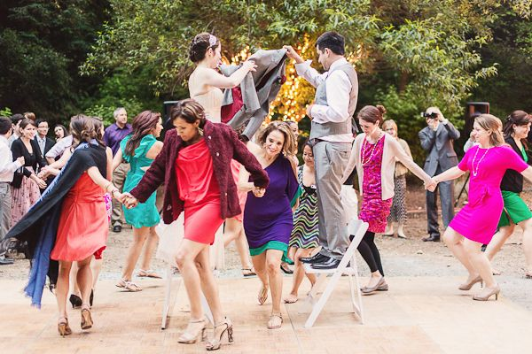 Instead of the traditional bouquet and garter toss, a Latin bride incorporated the Mexican wedding tradition of La Vibora, a crazy party version of the London Bridge children's game.
