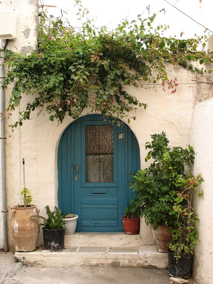 Greece --- colors similar to my front door,,, use red pots by the front door to add color! Good idea