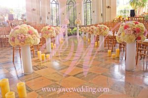 #Wedding #ceremony done at #Casa Loma, #luxury set up full of #fresh flower #arrangements and #candles on the grounds. The mixture of #flowers makes a perfect support of the hallway which looks #refreshing, #elegant and #romantic!