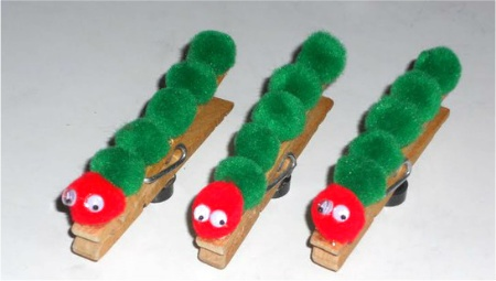 Very Hungry Caterpillar Craft! Small red and green poms with teeny tiny wiggle eyes can be glued using either a hot melt glue or E-6000 adhesive onto wooden clothespins backed with magnet disks or strips... very cute!