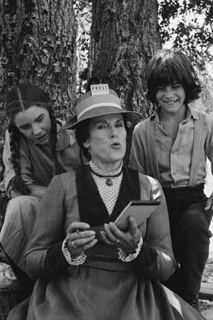 Little House on the Prairie- Laura and her brother Albert snoop on Mrs. Oleson's gossip column :)