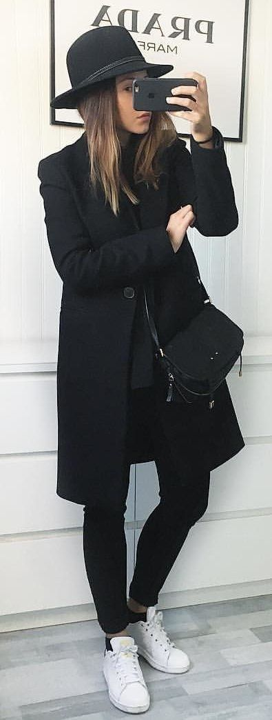 #winter #outfits  black long coat, black fitted jeans, white low-top sneakers and black hat outfit