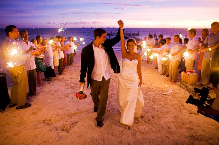 Evening beach wedding with sparklers! Awe, sparklers are always a good idea!