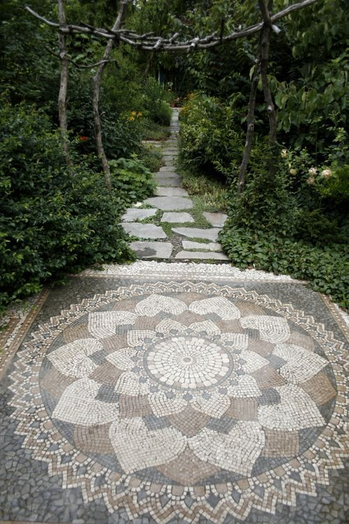 Beautiful stone mosaic on this garden path!