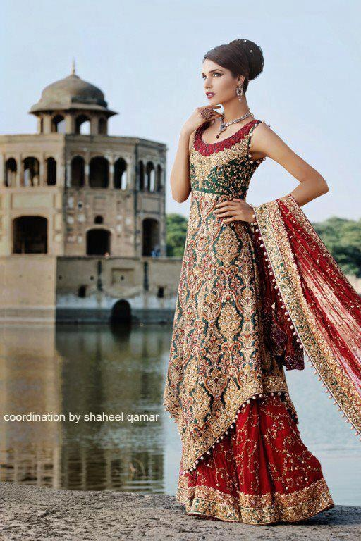 pakistani Wedding dress. Traditional red, green, and gold lengha. Unique shirt shape. Heavy work