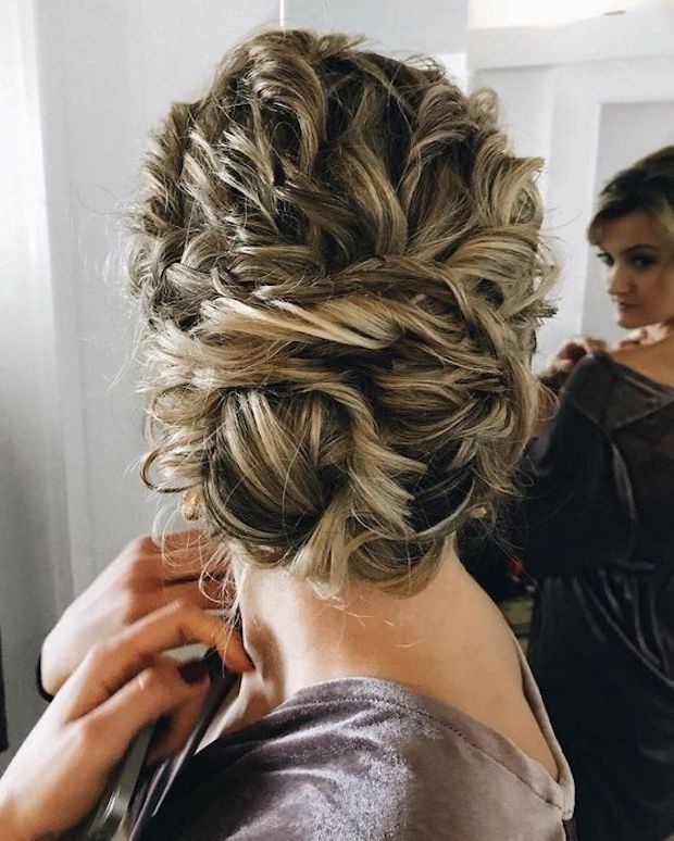 Tie Up Your Curly Hair Into A Large Twisted Low Bun It Will Look Very Textural And Messy Curly Hair Styles Naturally Curly Hair Styles Long Hair Styles
