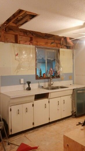 Officially started ripping down the other side of kitchen. Out with old uppers and bulk head. So much more space now.