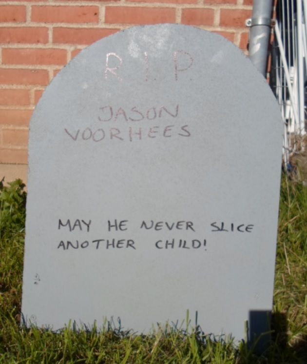 Tombstone for Jason Voorhees carved in wood and spraypainted grey.